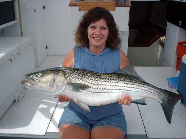 Gina is straining to hold this striper up for the photo.